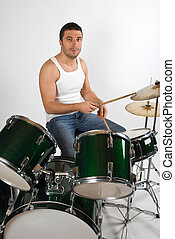 Young man drummer - Young attractive man drummer playing...