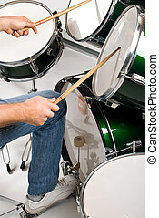 Drummer - Part of body drummer playing on drum set