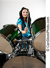 Drmmer with drum set - Young attractive woman holding...