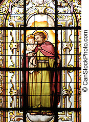 Saint Joseph holding baby Jesus, stained glass