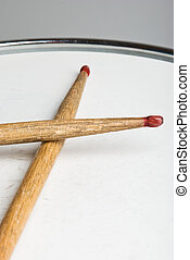 Drumsticks - Close up of old wood drumsticks on a drum