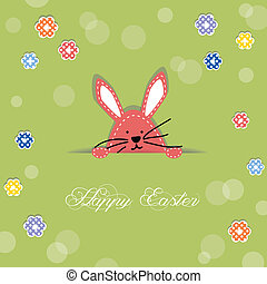Easter bunny poking its head out of cut in paper