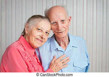 Senior Man, Woman with their Caregiver at Home Concept of...