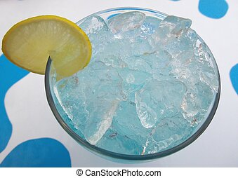Blue cocktail in glasses with lemon