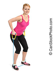 Back and arms exercise using rubber resistance band - Female...