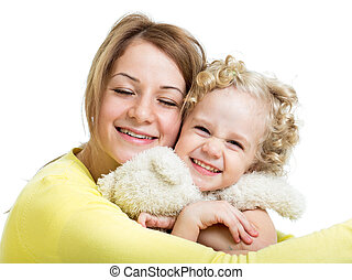 mother embracing with her kid girl and plush toy