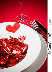 valentine day dinner to restaurant on red table background