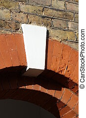 White Keystone - White keystone in arch in brick wall above...