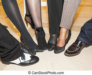 Collection of footwear on peoples feet - Selection of...