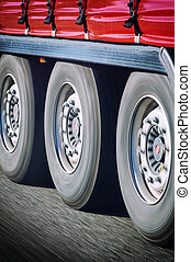 Truck wheels in motion - Close-up on spinning truck wheels...
