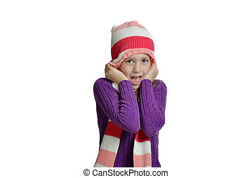 Expressive preteen girl wearing hat and scarf