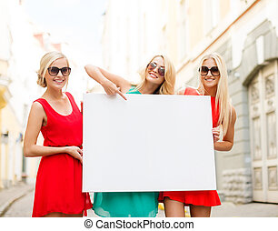 three happy blonde women with blank white board - summer...
