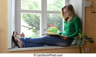 girl read book sill - girl sitting on window sill end...