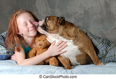 girl and her dog - pre teenage girl ready for cuddling with...