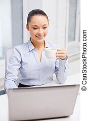 smiling businesswoman or student with laptop - office,...