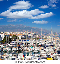 Altea village in alicante with marina boats foreground at...