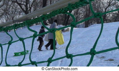 children climb hill fence
