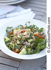 Healthy low fat couscous salad on outdoor table