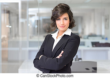 Business woman in an office. Crossed arms - Portrait of a...