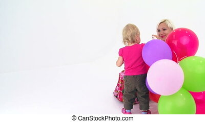 Holidays with balloons - Mother and daughter playing with...