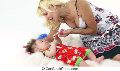 Mothers touch - Mother lulling her son