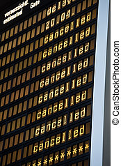 airport panel showing cancelled flights