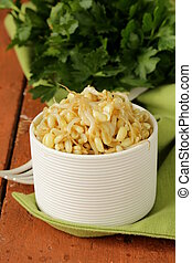 salad of sprouted mung beans in a white bowl