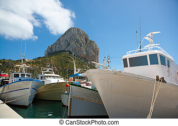 Calpe Alicante fisherboats with Penon de Ifach in...