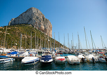 Calpe Alicante marina boats with Penon de Ifach mountain in...