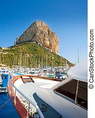 Calpe Alicante marina boats with Penon de Ifach mountain in...