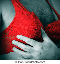a man wearing a red lace bra - a man in black and white...