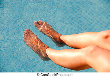 Soaking the feet in the pool - Nice legs of woman soaking...