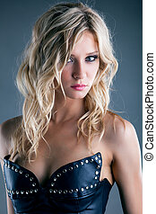 Portrait of charming young girl in leather corset, close-up