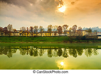 Autumn sunset in Florence - Autumn sunset on the banks of...
