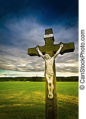 INRI - Summer evening in green and grassy fields with cross