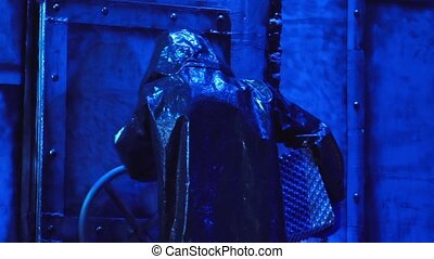 Man in protective suit - Closing door bins, a man in a gas...