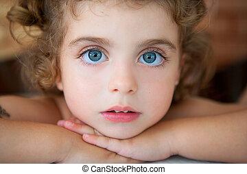 big blue eyes toddler girl looking at camera