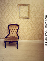 Antique upholstered chair in a wallpapered room with an...