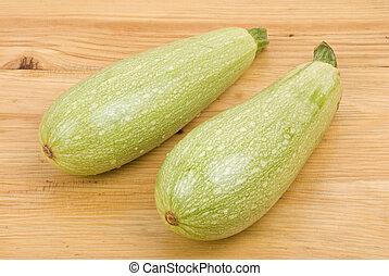 Vegetable marrow - Two big fresh vegetable marrow on wood...