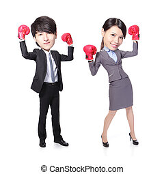 Business man and woman win pose with boxing gloves in full...