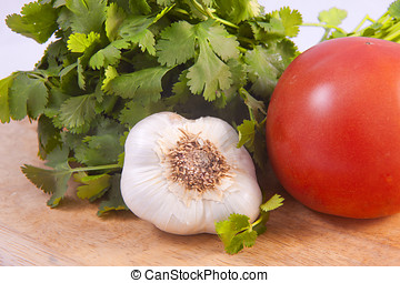 Cilantro, garlic, and a tomato. - The nutritious ingredients...
