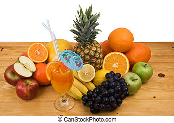 Fresh fruits and juice - Variety of fresh fruits and a glass...