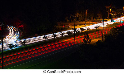 Headlight and Taillight Trails on a Busy Street at Night