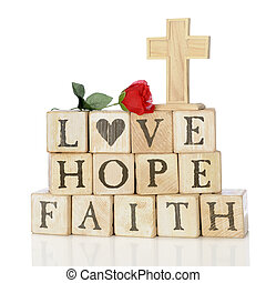 Faith, Hope and Love - Rustic wood alphabet blocks arranged...