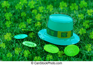 St Patrick's Day hat and coins on grass