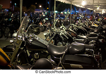 motorcycles exhibited at motorcycle show at night