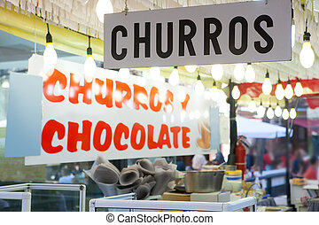 Churros and chocolate fritter typical food in Valencia Fallas