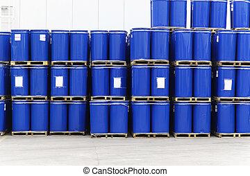 Barrels - Blue steel barrels with liquid material for...