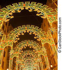 Beautiful night lights in Fallas fest of Valencia in calle...