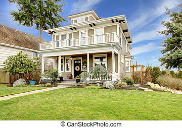 Two story american house with white column porch